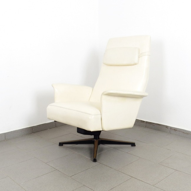 Swivel leatherette armchair